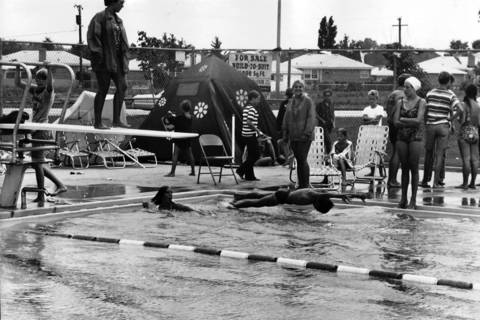 Aug. 19, 1970: A swimmer dives into a Niles Park District pool as part of a 37-member group trying to break the world record of 505 consecutive miles of swimming.