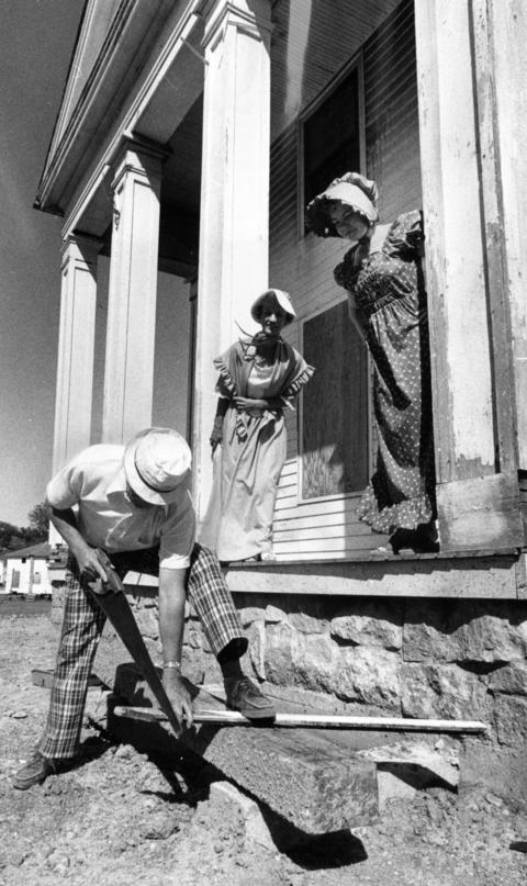 June 24, 1976: Carl Schraefer works on a restoration project at Naper Settlement as Shirley Pace, center, and Betty Wehrli offer encouragement.