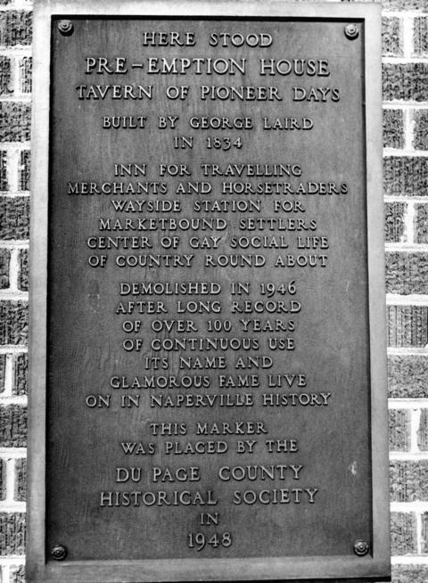 Dec. 10, 1959: A plaque commemorates the original Pre-Emption House, which stood at 37 W. Chicago Ave. and was demolished in 1946. A re-creation of the house is now at Naper Settlement.