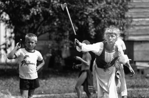 Aug. 20, 1990: Tomahawk thrower Kathy Dvorak lets one fly while Dan Cwiak, 9, looks on during the DuPage River Rendezvous at Naper Settlement.