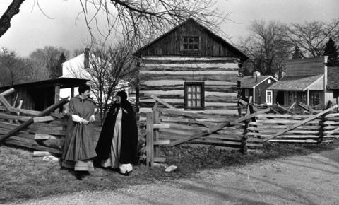 Feb. 16, 1990: Jane Morrison, left, and Grace Fry work at the Naper Settlement log house, built in 1830, teaching schoolchildren what winter was like for early settlers of Naperville.