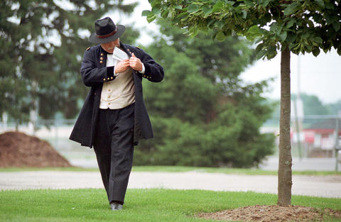 June 22, 1999: Theodore Kachel prepares for his performance as William Tecumseh Sherman at Naper Settlement. Through stories and acting, Kachel and four other Heartland Chautauqua scholars led audiences in an exploration of what life was like inside the Civil War.