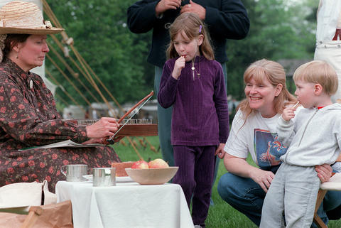 May 15, 1999: Pam Dopke, left, from Des Plaines, plays the psaltery (a stringed instrument), for Becky Trombley-Freytag and her two children, Kelley, 6, and Corey, 2, during Civil War Days at Naper Settlement.