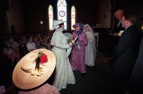 June 6, 1999: At a mock Victorian wedding held at Naper Settlement's Century Memorial Chapel, the groom's two aunts Gertrude and Gladys hold up the wedding.