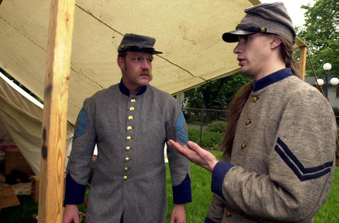 May 18, 2000: Reenactors Norm Camp of Villa Park, left, and Mark Chapas of Aurora discuss the historical roles they may take at Naper Settlement's Civil War Days.