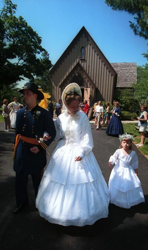 June 24, 2000: Costumed performers reenact a Victorian wedding at Naper Settlement.