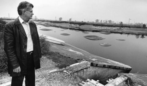 "Nov. 7, 1984: Army spokesman Douglas Thompson at the ""red water"" holding pond near the Joliet Army Ammunition Plant. The pond contained water that was once used in the manufacturing of TNT, and it had not been used for years."