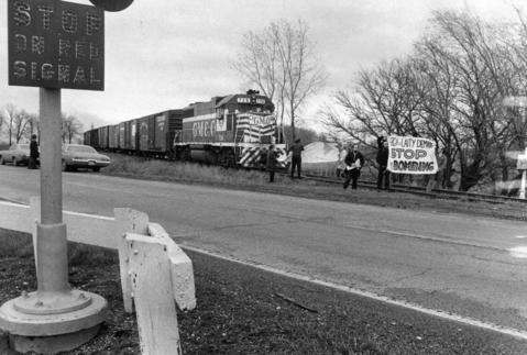 April 16, 1973: Protesters stand on train tracks at Joliet Army Ammunition Plant, blocking a freight train for two hours. The protesters said they were members of the Religious Resistance against U.S. Imperialism and were protesting the bombing of Cambodia. Five people were arrested.