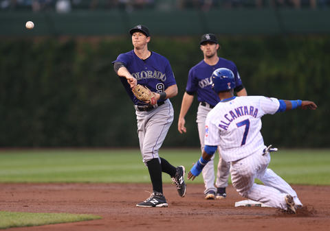 Rockies second baseman DJ LeMahieu forces Arismendy Alcantara out as Chris Coghlan grounds into a double play in the first inning.