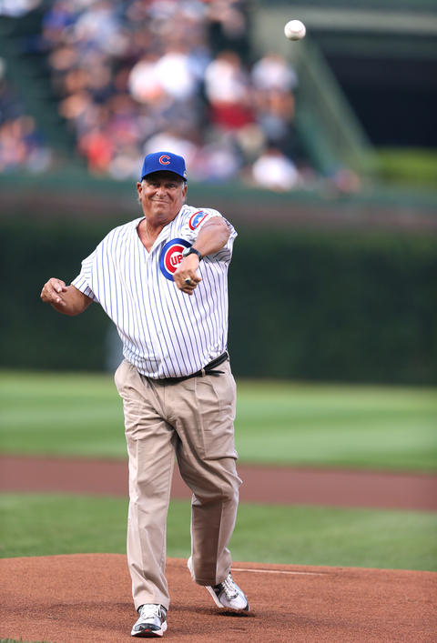 Former Cubs player Pete LaCock throws out the ceremonial first pitch.