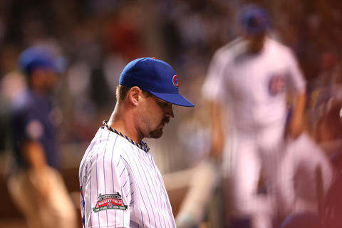 Cubs starting pitcher Travis Wood heads to the dugout after the top of the sixth inning.