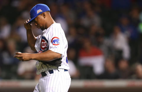Cubs relief pitcher Wesley Wright walks back to the mound after giving up a second run in the 10th inning.