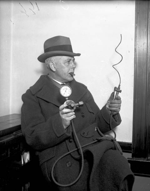 Capt. A. C. Townsend, a prohibition expert, shows off a device used to check beer, circa Dec. 18, 1925. Capt. Townsend was in command of the eleventh general prohibition division, with headquarters in Chicago.