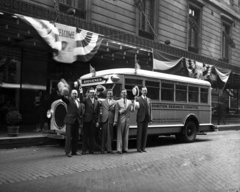 "The Prohibition Research Committee of New York's motorbus ""Diogenes"" stops in Chicago while on a national tour in search of a ""drunkard"" who has been reformed by the 18th Amendment, photographed June 11, 1932. At the end of their tour, they concluded that there was no man or family that benefited from Prohibition."
