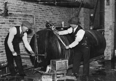 Police officers Thomas Roach and Patrick Bourke raid an alcohol-processing facility on West Randolph Street on Jan. 8, 1929.