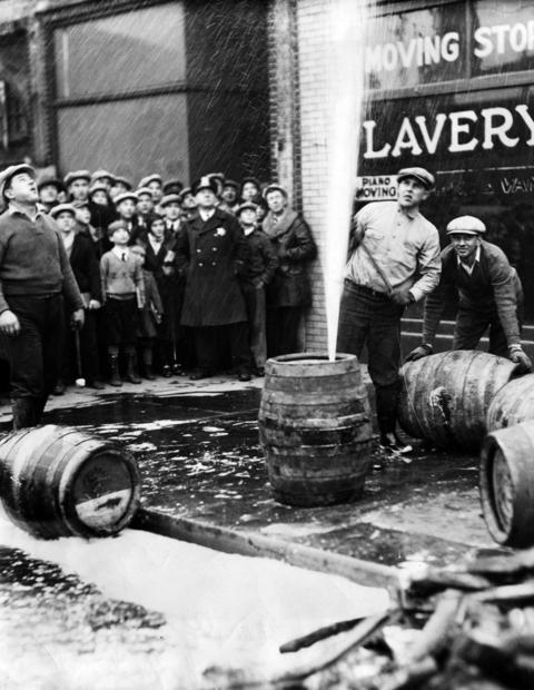 Prohibition agents Charles Jones, Thomas O'Brien and Michael Gary, break open some of the 537 barrels of beer they found in a raid on a garage at Lavery & Sons on S. Halsted Street on Jan. 11, 1932. After they were through with their work, a stream of beer flowed down Halsted Street.