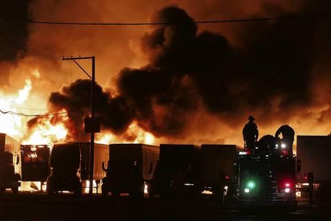 Semi-trailer trucks catch fire in the blaze.