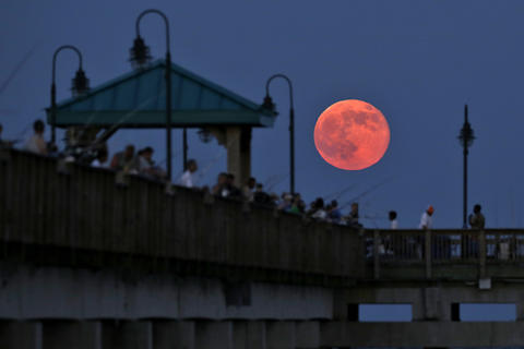 Staff Photo Of The Week: July 12-July 18, 2014 A super moon rises over the Buckroe Fishing Pier Saturday evening.