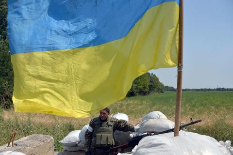 A Ukrainian serviceman guards a checkpoint near the eastern Ukrainian city of Debaltseve in the Lugansk region.