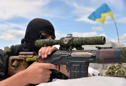A Ukrainian forces serviceman guards their position at the check-point near Slavyansk.