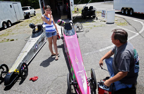 Eighteen year old Rachael Whitney works with her dad, Mike, to get her Jr. dragster ready to race at the Richmond Dragway. The former Menchville High student competes in a half scale dragster that tops out at 85 miles per hour. No Mags, No Sales, No Internet, No TV