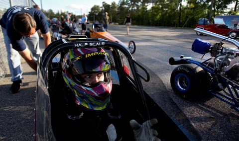 Rachael Whitney gets gets her gear on and prepares to race from in the staging lanes. To win a race, the driver has to either hit their dialed in time down the track or force the other driver to bust their time by a larger margin. No Mags, No Sales, No Internet, No TV