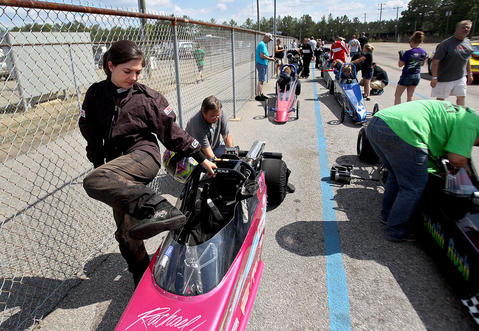 As her dad works on the motor, Rachael climbs into her dragster as it sits in the staging lanes at the Richmond Dragway. No Mags, No Sales, No Internet, No TV