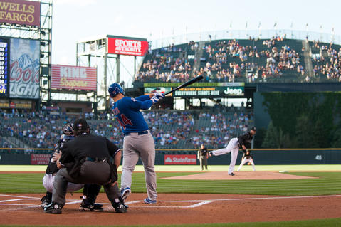 Anthony Rizzo hits a first inning sacrifice fly to score a run off of the Rockies' Jordan Lyles.