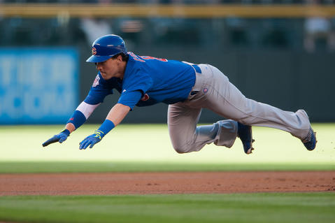 Chris Coghlan slides head first into third base with a leadoff triple.