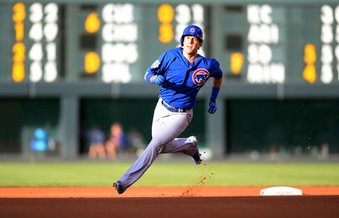 Chris Coghlan rounds second on his way to a triple in the first inning.