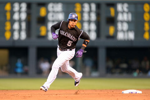 The Rockies' Carlos Gonzalez rounds second on his way to score in the fourth inning.