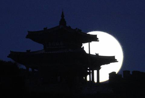 A supermoon rises behind Hwaseong Fortress in Suwon, South Korea.