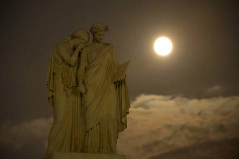 This picture provided by NASA shows a supermoon over the The Peace Monument on the grounds of the U.S. Capitol.