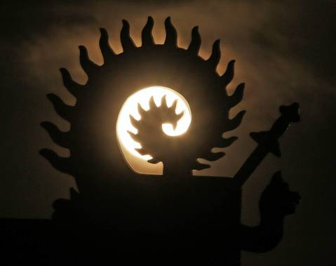 The supermoon as seen through a statue in Jilin, northeast China's Jilin province.