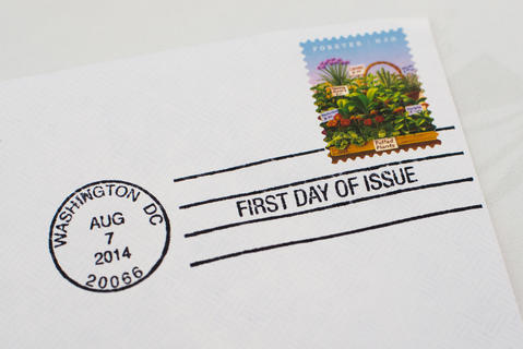 2014, August 07 - WASHINGTON DC - A new farmers market commemorative stamp on a first-day-of-issue envelope is sold at a dedication ceremony in Washington. The stamps feature colorful scenes of a farmers market: eggs, sunflowers, peppers and loaves of bread, all painted in overflowing baskets.
