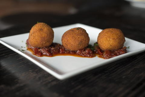 Arancini with smoked cacciocavallo cheese and tomato jam served at Webster's Wine Bar, 2601 N. Milwaukee Ave. in Logan Square.