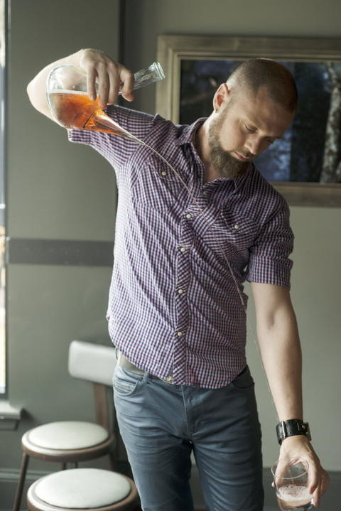 Bartender Dylan Jones pours Spanish wine Ameztoi Rubentis txakolina in the traditional fashion from a Spanish made carafe made specifically for this wine at Webster's Wine Bar, 2601 N. Milwaukee Ave. in Logan Square.