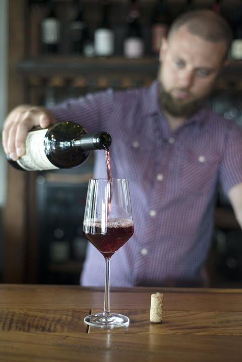 Bartender Dylan Jones pours Pipeno Vino Puro De Uva Portozuelo, a Chilean wine available by the glass, two-ounce pour and bottle at Webster's Wine Bar, 2601 N. Milwaukee Ave. in Logan Square.