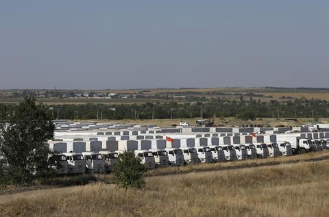A Russian convoy of trucks carrying humanitarian aid for Ukraine is parked at a camp near Kamensk-Shakhtinsky.