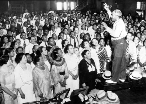 "J. Wesley Jones, choral director, leads 600 African-American singers through a rehearsal at the Metropolitan Community Church in 1935. The group was rehearsing for the upcoming Chicagoland Music Festival where they would sing ""Oh Southland"" and ""Swing Low, Sweet Chariot"" at Soldier Field in Aug. 1935."