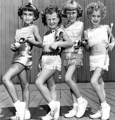 Pee-wee baton twirlers Diane Shelton, 8, from left, Mary Jo Hall, 8, Toni Marie Cochran, 7, and Diana De Wild, 7, performed at the Chicagoland Music Festival at Soldier Field in 1954.