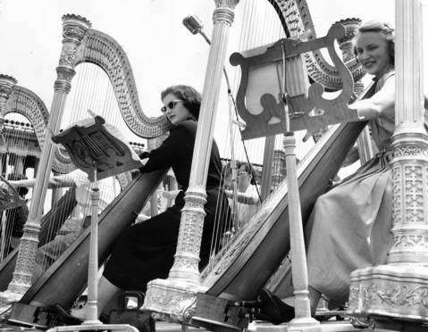 Dolly Flanagan, center, and Carol Albrecht, right, play harps during the Chicagoland Music Festival at Soldier Field on Aug. 19, 1950.