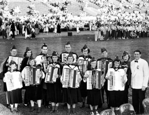 Director John Dickerson stands next to the Monarch Music Marvels, who won the AA Class at the Chicagoland Music Festival on Aug. 23, 1952, at Soldier Field.