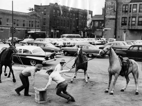 Cowboys Pete Spogis, from left, Bill Hayes, and Dan Kennedy, rehearse a musical chairs game that they will perform at the Chicagoland Music Festival on Aug. 24, 1957. The photo was taken on Aug. 14, 1957.