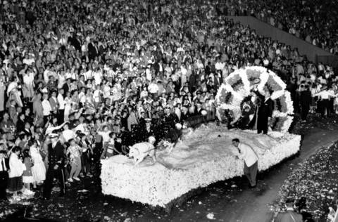 Bob Hope waves to the crowd from a float at the Chicagoland Music Festival held at Soldier Field on Aug. 23, 1958.