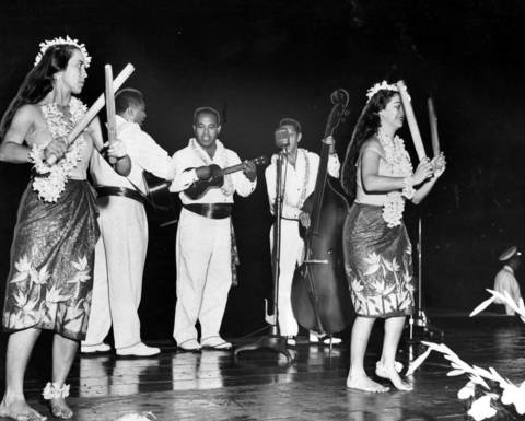 Hawaiian entertainers perform songs of the islands at the Chicagoland Music Festival in Aug. 1960. The group was directed by Joe Kahaulelio, entertainment director of the Hawaii Visitors Bureau.