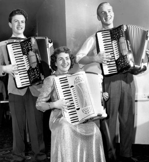 Arlene Einz, a Class A accordion solo winner, and Ken Olendorf, left, and James Chiotti, right, are given superior ratings, in Aug. 1950, after the Chicagoland Music Festival.