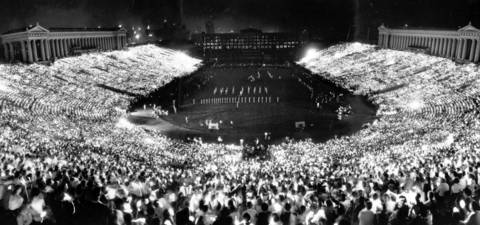 Spectators hold up matches to light up Soldier Field during a ceremony that is a highlight of the Chicagoland Music Festival in 1961.