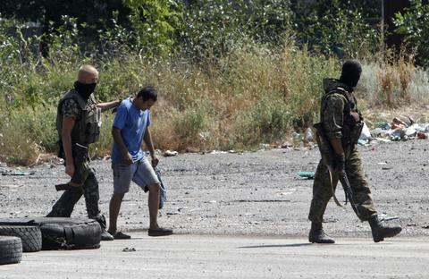 Ukrainian servicemen detain a pro-Russian activist at a checkpoint near the eastern Ukrainian town of Debaltseve, August 16.