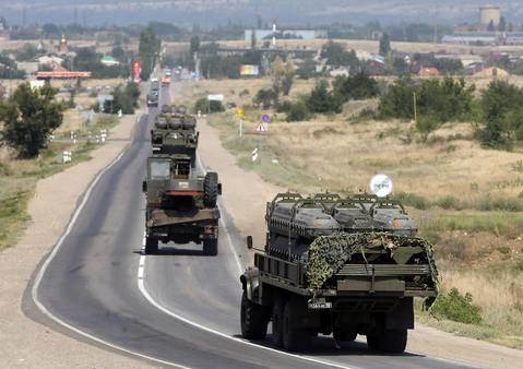 Russian military vehicles loaded with shipping containers for missiles of BUK-M1 air defense missile system drive along the road outside Kamensk-Shakhtinsky, Rostov Region, August 16.